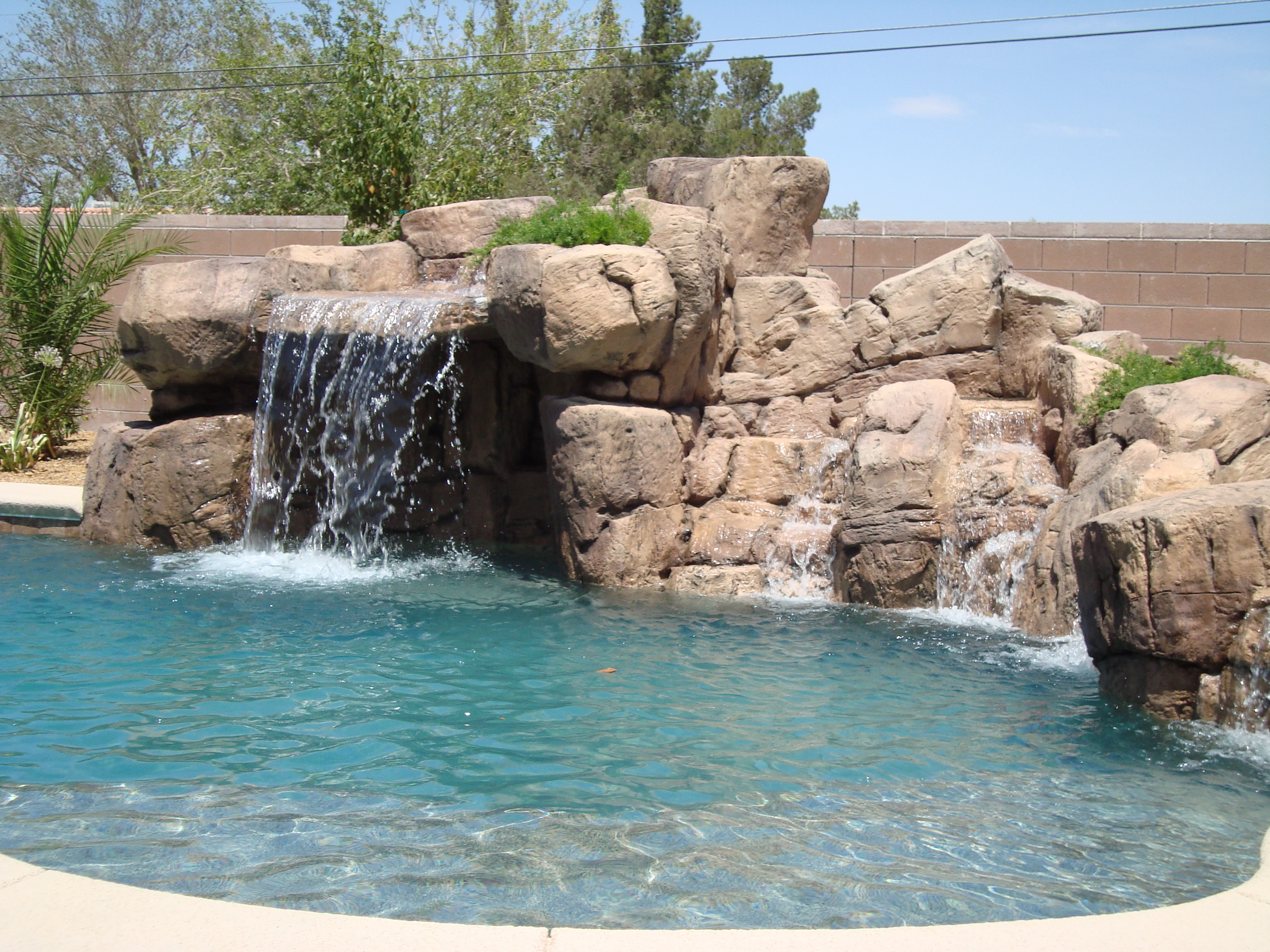 Rock slides for pools home design and decor for Az pond and pool